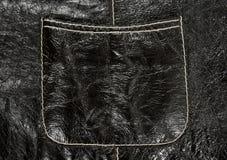 Pocket on black leather clothing Stock Photography