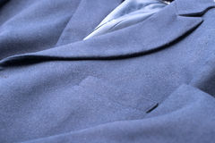 Pocket on the blue coat Stock Photography