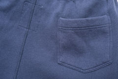 Pocket on Blue Fabric Stock Image