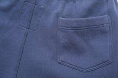 Pocket on Blue Fabric Stock Image