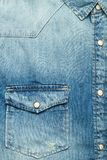 Pocket of a blue jean shirt. In a close up view Stock Images