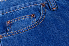 Pocket blue jeans. The delayed pocket of dark blue jeans a background Stock Photography