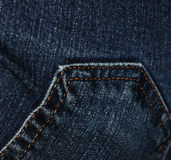 Pocket on bluejeans. Close-up of back pocket on bluejeans, showing detail of stitching stock photo