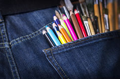 Pocket with brushes and pencils Royalty Free Stock Photos