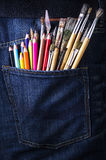 Pocket with brushes and pencils Royalty Free Stock Images