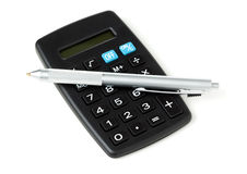 Pocket calculator and ballpoint pen Royalty Free Stock Image