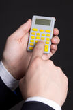 Pocket calculator in business man hands Stock Photography
