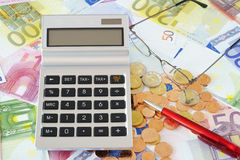 Pocket calculator on Euro Banknotes Royalty Free Stock Photography