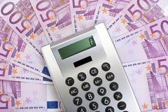 Pocket calculator on 500 euro bills Royalty Free Stock Image