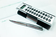 Pocket calculator and pen on the table Royalty Free Stock Photography