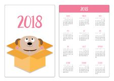 Pocket calendar 2018 year. Week starts Sunday. Adopt me. Dont buy. Dog inside opened cardboard package box. Ready for a hugging. P. Uppy pooch looking up. Pet Royalty Free Stock Photos