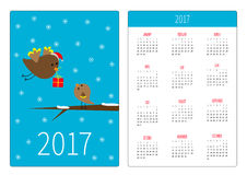 Pocket calendar 2017 year. Week starts Sunday. Flat design Vertical orientation Template. Flying bird with girt box and baby birdi. E. Merry Christmas card Stock Photo