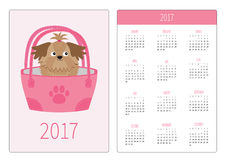 Pocket calendar 2017 year. Week starts Sunday. Flat design Vertical orientation Template. Little glamour tan Shih Tzu dog in the b. Ag. Vector illustration Royalty Free Stock Photo