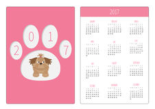 Pocket calendar 2017 year. Week starts Sunday. Flat design Vertical orientation Template. Little glamour tan Shih Tzu dog in the paw print. Vector illustration Stock Photo