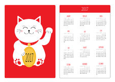 Pocket calendar 2017 year. Week starts Sunday. Flat design Vertical orientation Template. Lucky cat holding golden coin. Japanese. Maneki Neco kitten waving Stock Photography