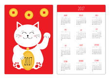 Pocket calendar 2017 year. Week starts Sunday. Flat design Vertical orientation Template. Lucky cat holding golden coin. Japanese Maneki Neco kitten waving Royalty Free Stock Image