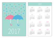 Pocket calendar 2017 year. Week starts Sunday. Flat design Vertical orientation Template. Pink and blue umbrellas. Rain in shape o Royalty Free Stock Photos