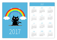 Pocket calendar 2017 year. Week starts Sunday. Flat design Vertical orientation Template. Rainbow two clouds in the sky and cat on the swing. Dash line. Blue Royalty Free Stock Image