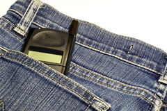 Pocket cellphone. An image of a generic mobile phone in a denim jeans pocket royalty free stock photos