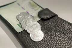 Pocket Changes Spread out on a Leather Wallet stock photo