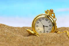Pocket clock on the beach Royalty Free Stock Images