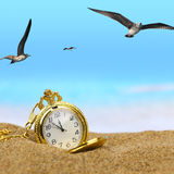 Pocket clock on the beach Royalty Free Stock Image