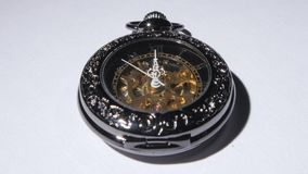 Pocket clock. Close up. Antique clock, vintage pocket watch, luxury, gold pocket watch, close up stock video footage