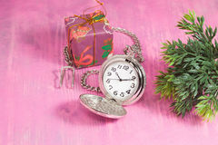 Pocket clock and gift box on pink Stock Images