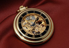 Pocket clock in gold Stock Images