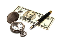 Pocket clock, pen and banknote Stock Photos