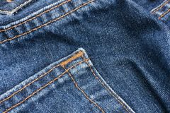 Pocket detail of blue denim jeans Stock Image