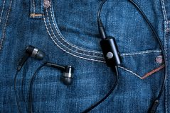 Pocket with earphones Stock Photography