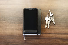 Pocket essentials - notebook, mobile phone, keys Stock Images