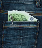 Pocket with euro. Pocket of blue jeans with cuts euro Royalty Free Stock Images