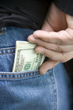 Pocket Full of Money Stock Photo