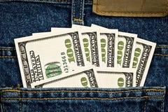 Pocket Full of Money Stronger. A dark blue jean pocket full of one hundred dollar bills Stock Images