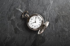 Pocket gray clock on dark gray Royalty Free Stock Photos