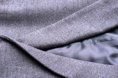 Pocket on the gray coat Royalty Free Stock Photography