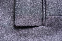 Pocket on the gray coat Stock Photo