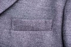 Pocket on the gray coat Stock Photos