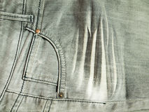 Pocket on grey jeans. Background Stock Photo