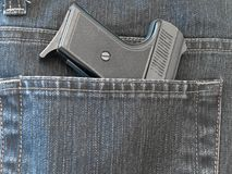 Pocket with gun Royalty Free Stock Photo