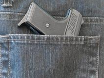 Pocket with gun Royalty Free Stock Photo