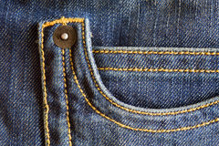 Pocket jeans. Pocket of trousers in denim blue with yellow stitching Stock Images