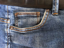 The pocket of jeans. Clothes fashion style pants material cloth cotton color blue belt Royalty Free Stock Photography