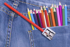 Pocket Jeans and colorful pencils Stock Image