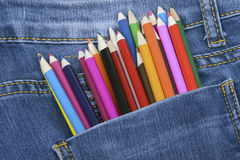 Pocket Jeans and colorful pencils Stock Photos