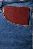 The pocket of jeans with document. Cloth background Royalty Free Stock Images