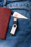 The pocket of jeans with document, money amd flash card. Cloth b Royalty Free Stock Photography