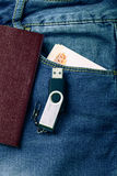 The pocket of jeans with document, money amd flash card. Cloth b Stock Photo